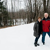 Beth Ann and Harald Scheid stand on their land in Ashby, which they hope to develop into a compact living community. SENTINEL & ENTERPRISE / Ashley Green