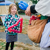 Callie Messamore, 6, waits for a balloon animal from Ed the Wizard during the Ashby Pumpkin Fest on Saturday afternoon. SENTINEL & ENTERPRISE / Ashley Green