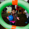 Maeve McKenzie, 3, plays the noodle toss game during the Ashby Pumpkin Fest on Saturday afternoon. SENTINEL & ENTERPRISE / Ashley Green
