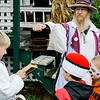 Ed the Wizard entertains a crowd during the Ashby Pumpkin Fest on Saturday afternoon. SENTINEL & ENTERPRISE / Ashley Green