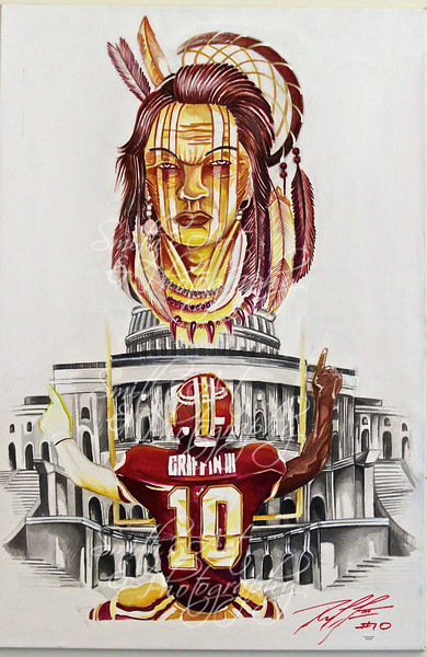 """Part of """"Gridiron Series"""" by Ian Asher Smith. This painting is 24x36"""" that was signed and authenticated by Robert Griffin in Dulles Virgina in 2012.Origin is to commemorate the first touchdown for RG3 in the New Orleans Super Dome to Peirre Garcon."""