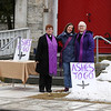 HOLLY PELCZYNSKI - BENNINGTON BANNER Reverends Kathy Clark, of the Federated Church of East Arlington, and Kathleen More and Mary White of St. James Episcopal Church of Arlington wait to give ashes in front of the church during the Ashes To Go offering on Wednesday afternoon.