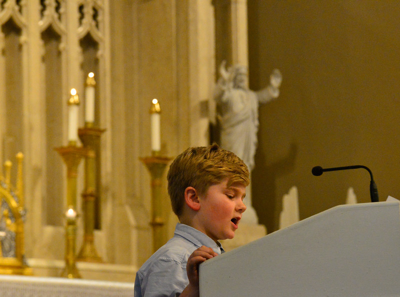 KRISTOPHER RADDER — BRATTLEBORO REFORMER<br /> Joshua Chechile, a third-grader at St. Michael's Catholic School, in Brattleboro, Vt., does a reading during an Ash Wednesday service at St. Michael's Catholic Church on Wednesday, Feb. 26, 2020.