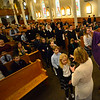 KRISTOPHER RADDER — BRATTLEBORO REFORMER<br /> Father Justin Baker, of St. Michael's Catholic Church, in Brattleboro, Vt., and others put ashes onto parishioners' heads during an Ash Wednesday service on Wednesday, Feb. 26, 2020.