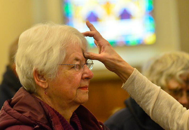 KRISTOPHER RADDER — BRATTLEBORO REFORMER<br /> Carol Johnson, of Vernon, Vt, receives ashes during an Ash Wednesday service at St. Michael's Catholic Church, in Brattleboro, Vt., on Wednesday, Feb. 26, 2020.