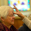 KRISTOPHER RADDER — BRATTLEBORO REFORMER<br /> Carol Johnson, of Vernon, Vt, receives ashes during an Ash Wednesday service at St. Michael's Catholic Church, in Brattleboro, Vt., on Wednesday, Feb. 26, 2020.