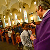 KRISTOPHER RADDER — BRATTLEBORO REFORMER<br /> Sam Buchanan, a seventh-grader at St. Michael's Catholic School, in Brattleboro, Vt., receives ashes from Father Justin Baker, of St. Michael's Catholic Church, during an Ash Wednesday service at St. Michael's Catholic Church on Wednesday, Feb. 26, 2020.