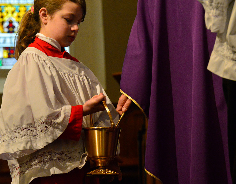 KRISTOPHER RADDER — BRATTLEBORO REFORMER<br /> Helena Valin, a fifth-grader at St. Michael's Catholic School, in Brattleboro, Vt., holds the holy water as Father Justin Baker, of St. Michael's Catholic Church, blesses the ashes during an Ash Wednesday service at St. Michael's Catholic Church on Wednesday, Feb. 26, 2020.