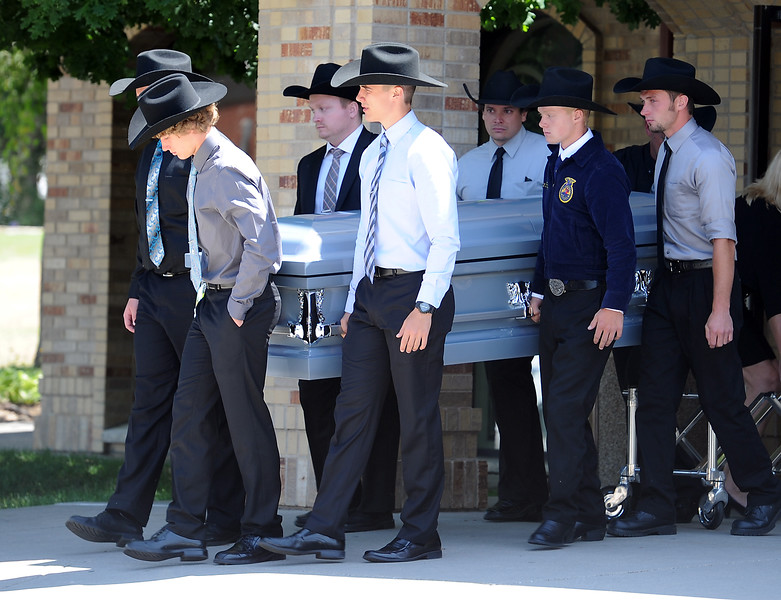 Pallbearers, which include brothers Michael Doolittle and Branden Kratochvil, carry Ashley Doolittle's casket to the hearse after her funeral mass Friday, June 17, 2016, at Saint John the Evangelist Catholic Parish in Loveland. (Photo by Jenny Sparks/Loveland Reporter-Herald)