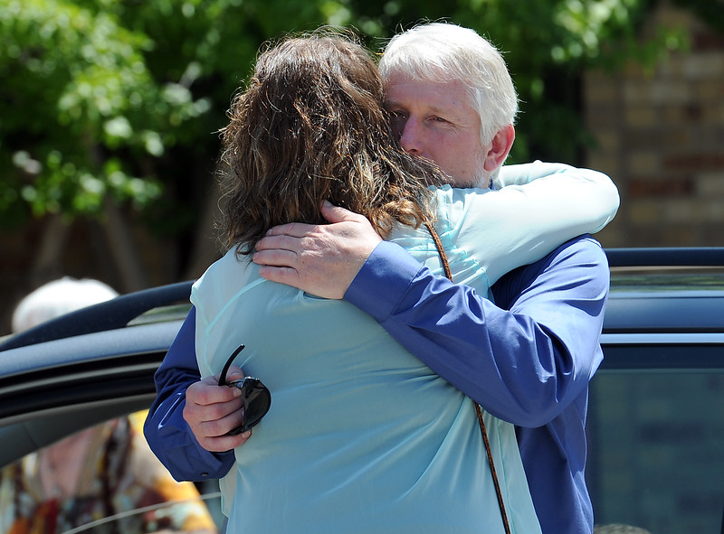 Family friend Denise Kramlich hugs Jeff Doolittle, Ashley Doolittle's father, moments  after her funeral mass Friday, June 17, 2016, at Saint John the Evangelist Catholic Parish in Loveland. (Photo by Jenny Sparks/Loveland Reporter-Herald)