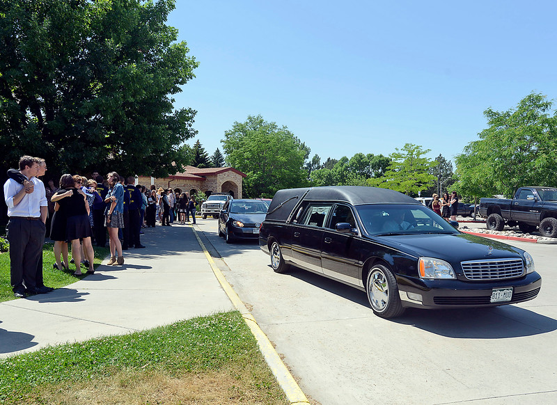 Folks gather as the hearse carrying Ashley Doolittle's casket leaves St. John the Evangelist Catholic Parish after her funeral mass Friday, June 17, 2016, in Loveland. (Photo by Jenny Sparks/Loveland Reporter-Herald)