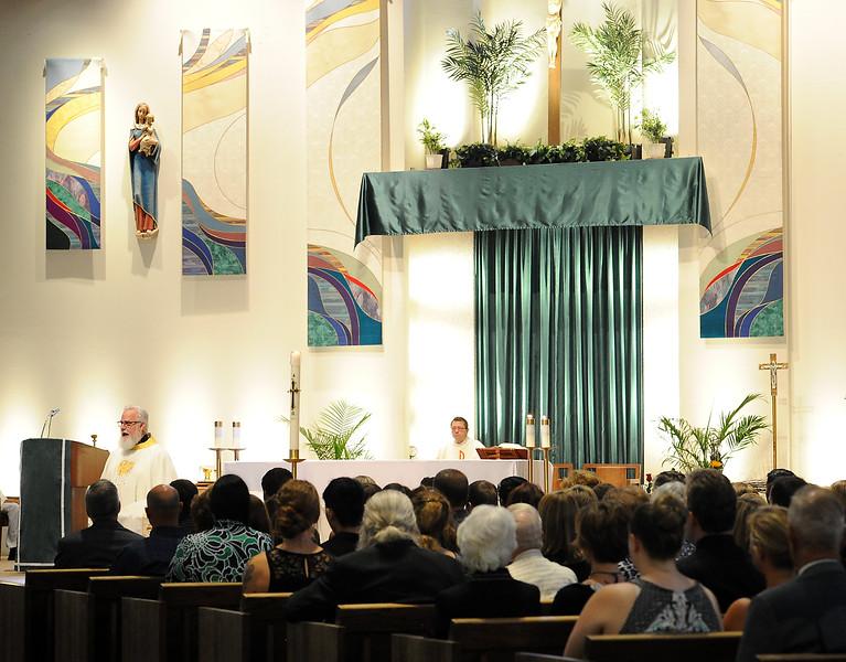 Father Steve Adams speaks during Ashley Doolittle's funeral mass Friday, June 17, 2016, at Saint John the Evangelist Catholic Parish in Loveland. (Photo by Jenny Sparks/Loveland Reporter-Herald)