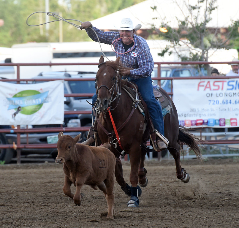 . Lance Stevens competes in the steer wrestling during the Ashley Doolittle Memorial Rodeo on June 10, 2017. For more photos, go to www.dailycamera.com. Cliff Grassmick / Staff Photographer/ June 10, 2017