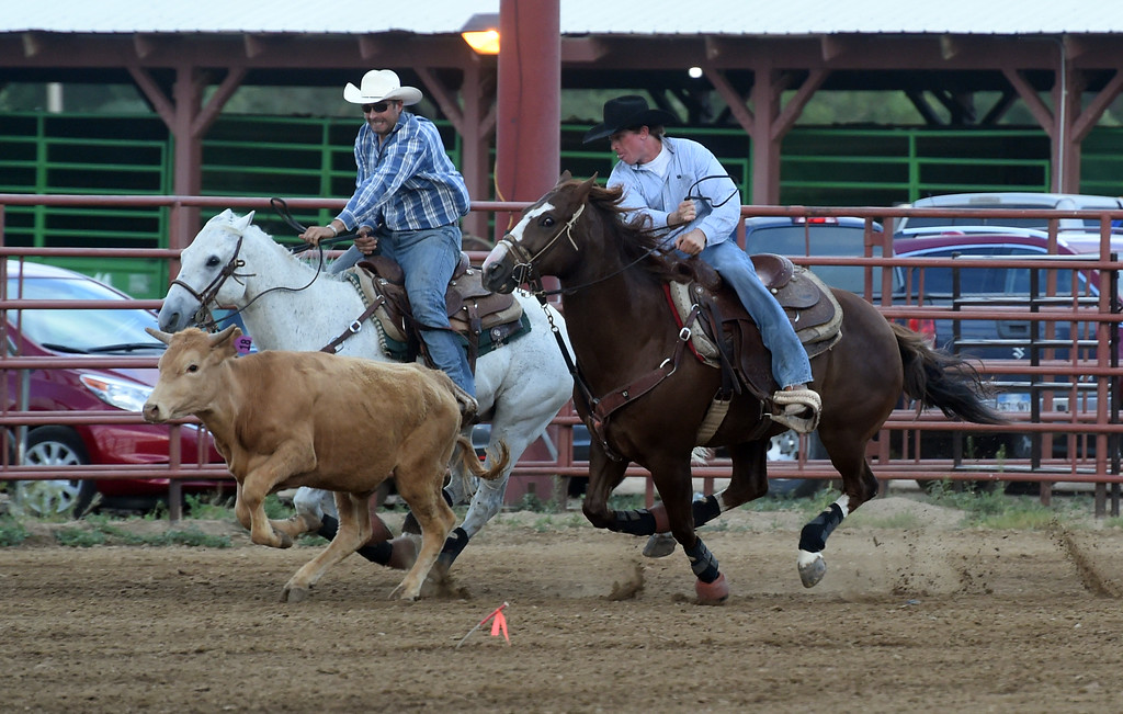 . Cole Dorenkamp, right, competes in the steer wrestling during the Ashley Doolittle Memorial Rodeo on June 10, 2017. For more photos, go to www.dailycamera.com. Cliff Grassmick / Staff Photographer/ June 10, 2017