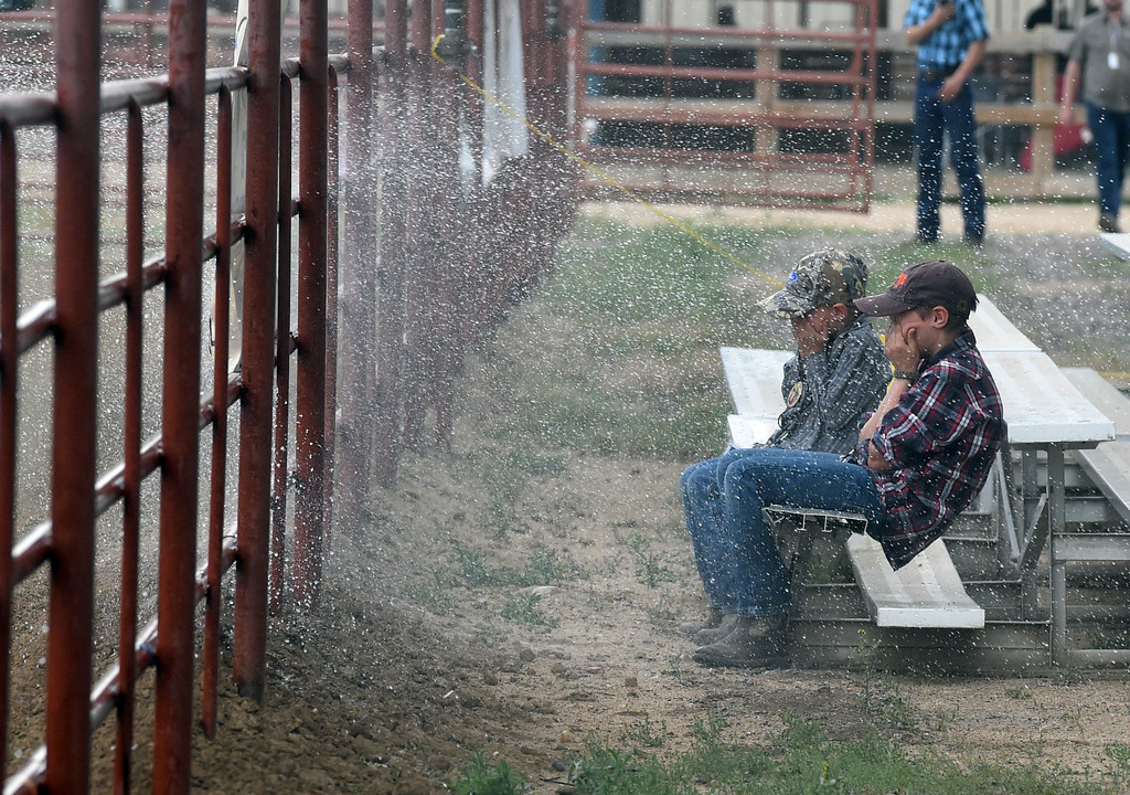 . Reid and Seth Anderson get soaked by the arena sprinkler during the Ashley Doolittle Memorial Rodeo on June 10, 2017. For more photos, go to www.dailycamera.com. Cliff Grassmick / Staff Photographer/ June 10, 2017