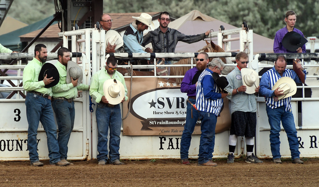 . The cowboys and riders honor Ashley Doolittle with hats off during the Ashley Doolittle Memorial Rodeo on June 10, 2017. For more photos, go to www.dailycamera.com. Cliff Grassmick / Staff Photographer/ June 10, 2017