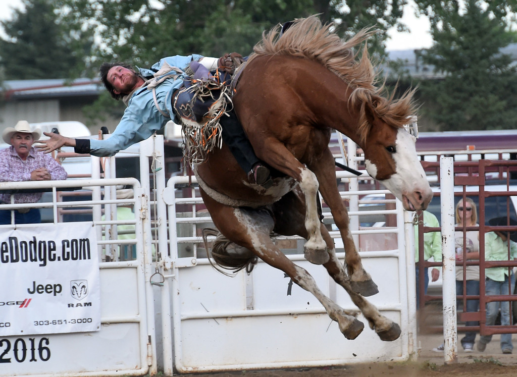 . Tyler Ferguson stays on his horse during bareback riding during the Ashley Doolittle Memorial Rodeo on June 10, 2017. For more photos, go to www.dailycamera.com. Cliff Grassmick / Staff Photographer/ June 10, 2017