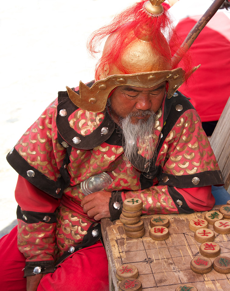 Chinese chess (Xiangqi) player, Panjiyuan (Dirt) Market, Beijing (c)2012