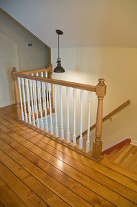 Farm house remodeling - the new stairway and refinished knotty pine floor