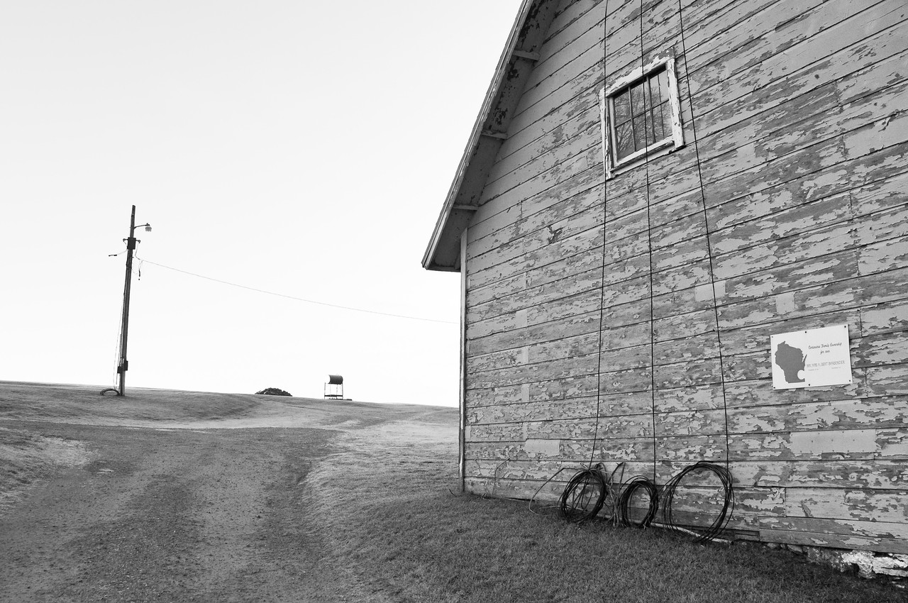 Farmstead - building - granary/shed - old wire before being replaced by underground wires