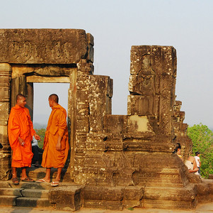monks on top of the sunset temple