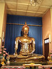 The gold statue of Buddha at Wat Trai Mit, about 800 years old, was revealed underneath a plaster Buddha statue only half a century ago.