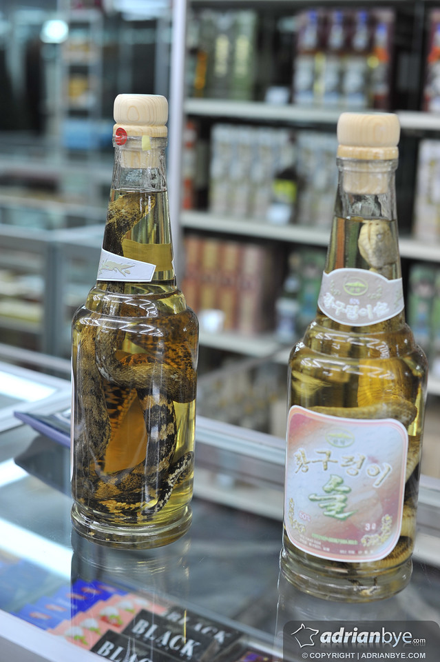 This is snake alcohol, apparently also popular in Vietnam.  The snake venom is made safe by the alcohol.  Apparently drinking this makes you virile!
