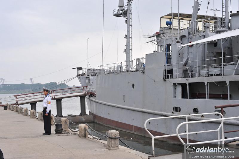 North Korean navy standing on guard in front of the USS Pueblo captured in the 1960s