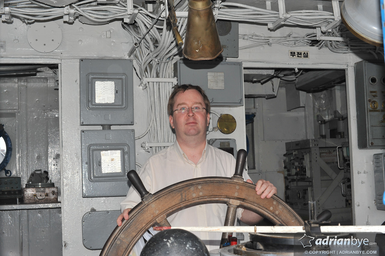 Me at the helm of the USS Pueblo.  It was an odd feeling.