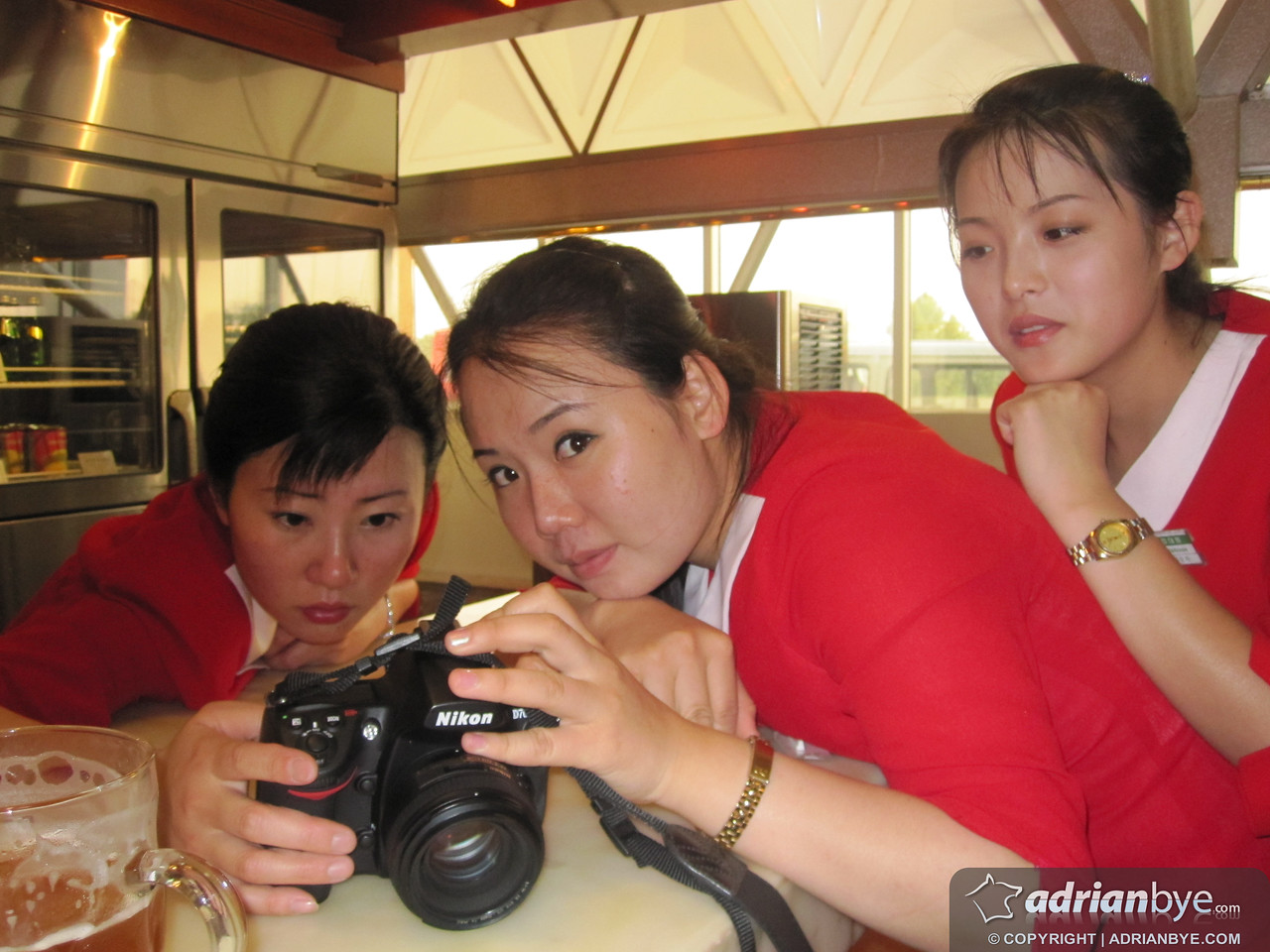 A group of the waitresses checking out my camera; they were fascinated by it