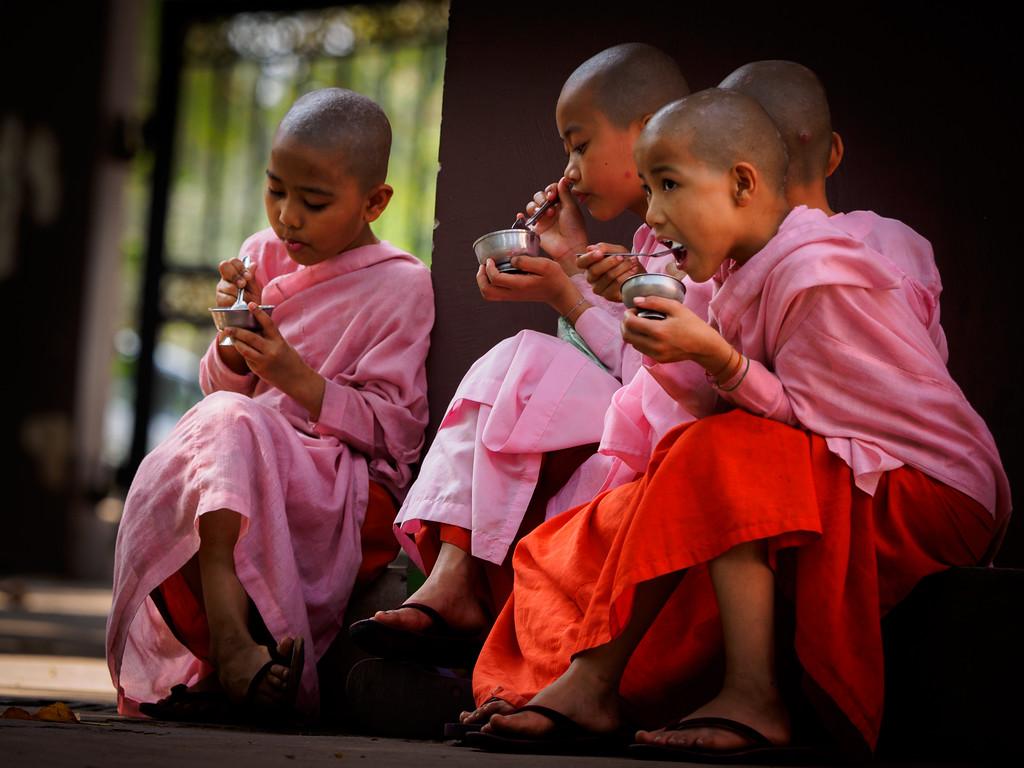 Young nuns enjoying ice-cream