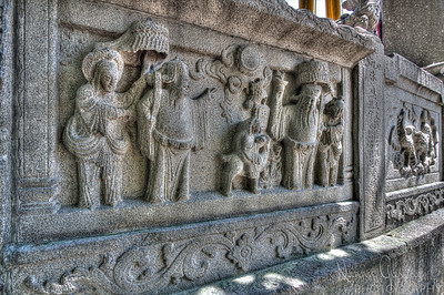 Stone carving in temple wall in Macau