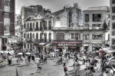 The pedestrian streets in Macau's shopping area are bustling with activities.