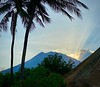 Sunset behind Mt. Agung, Bali's tallest mountain, which erupted two years ago in 2017