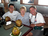 Kevin, Carolyn & George, greeted with refreshing coconut drinks (after 23 hours of flying to reach Sorong!)