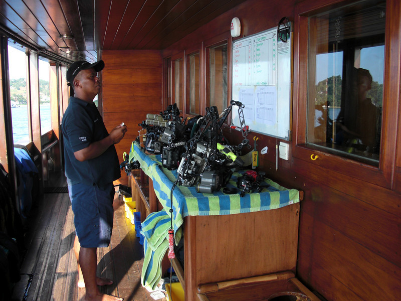 AA II staff checking the dive board, in order to prepare dive equipment and camera gear for loading onto dive skiffs