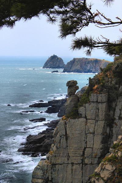 """Stone Buddha"" along the Igidae Coastal Walk (cliff side walk) in Busan, Korea."