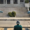 FACE OFF:  ROK (Republic of Korea) MP face the Panmungak Pavilion in North Korea where a North Korean soldier keep watch on the activity on the south side of the demarcation line.  This is a very tense area of the JSA (Joint Security Area) of the DMZ (DeMilitarized Zone).