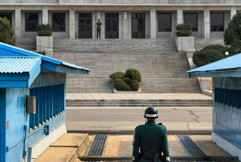 ROK (Republic of Korea) MP face the Panmungak Pavilion in North Korea where a North Korean soldier keep watch on the activity on the south side of the demarcation line. This is a very tense area of the JSA (Joint Security Area) of the DMZ (DeMilitarized Zone).