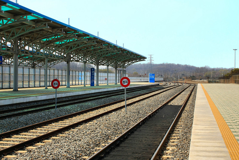 NEXT STOP: NORTH KOREA - tracks into the North<br /> <br /> The deserted Dorasan Train Station in the DMZ is a poignant place where Korean hope for reunification is palpable. The Dorasan Station is the last stop on the KTX before heading into North Korea, as seen in this photo (this is North Korea). The tracks run from Busan through Seoul almost to Pyongyang, North Korea, however the train itself goes no further than Seoul because of heated tensions between the north and south Koreas.<br /> <br /> In 2002, U.S. President George W. Bush visited the station and gave a speech expressing hope for the future that families divided by war and the North/South Korean conflict would someday be united through this railroad.