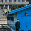 This posture by the ROK soldier is significant: he is standing 1/2 shielded by the blue building and 1/2 visible to the North Koreans. This shows he is on the offensive and defensive.