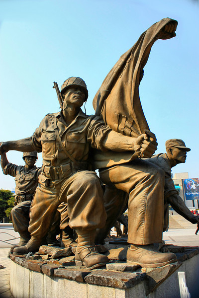 Statue of US soldiers leading the way to safety for South Koreans during the Korean War at the War Memorial of Korea in Seoul, Korea.