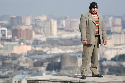 Baku, Azerbaijan - February 2008: Azeri man standing over a view over the oil rich Azeri capital city of Baku. (Photo by Christopher Herwig)