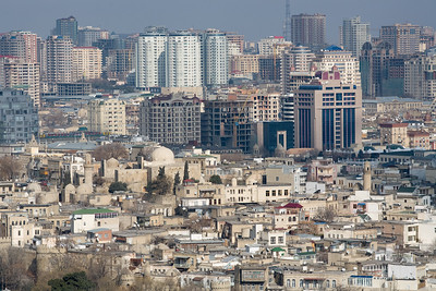 Baku, Azerbaijan - February 2008: Overview over the oil rich Azeri capital city of Baku.  The old city with its narrow streets and old mosques is contrasted by modern skyscapers in the back. (Photo by Christopher Herwig)