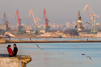 Baku, Azerbaijan - February 2008: Young couple share a moement on the waterside of the oil rich port city of Baku, in Azerbaijan on the shores of the Caspian Sea. (Photo by Christopher Herwig)