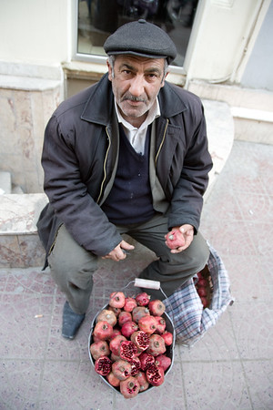 Baku, Azerbaijan - February 2008: Azeri man selling pomegranates in downtown Baku, Azerbaijan. (Photo by Christopher Herwig)