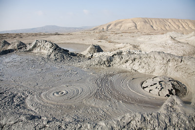 Qobustan, Azerbaijan - February 2008: Bubbling mud volcanoes outside Qobustan in Azerbaijan. The strange geological landcape draws the odd tourist to this otherwise deserted area.  (Photo by Christopher Herwig)
