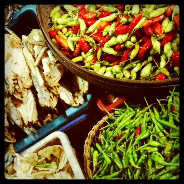 Ingredients for Balinese cooking - chili peppers and dried fish. Ubud market, Bali