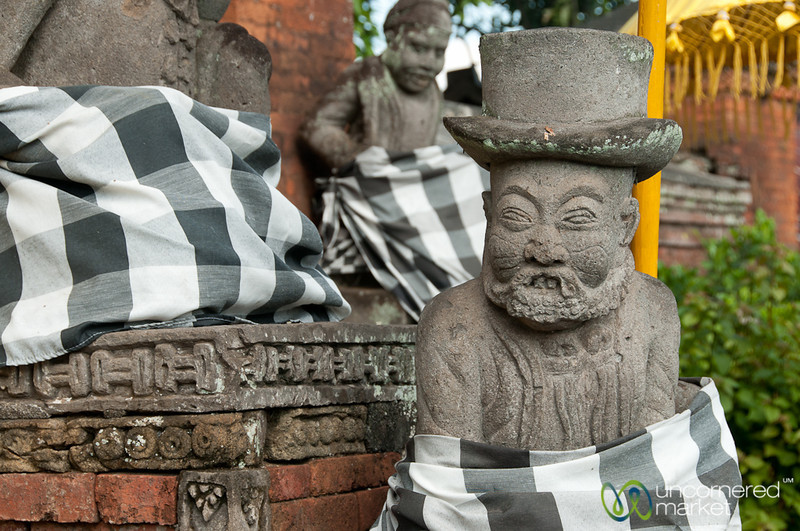 Statues in Top Hats at Semarapura Pavillions - Bali, Indonesia