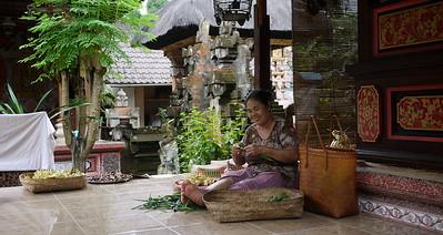 Woman making Balinese offerings